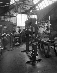 3 men in workshop