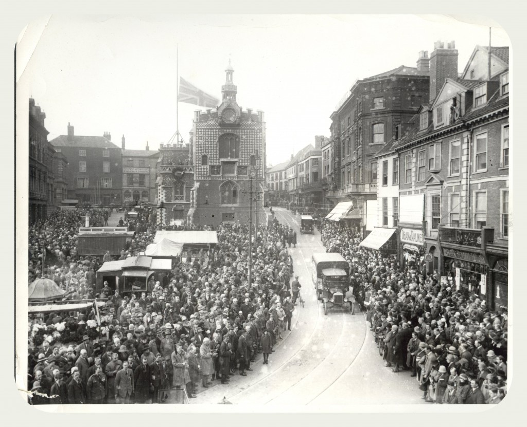 Vehicles driving through Norwich City Centre on Armistace Day, 1926.